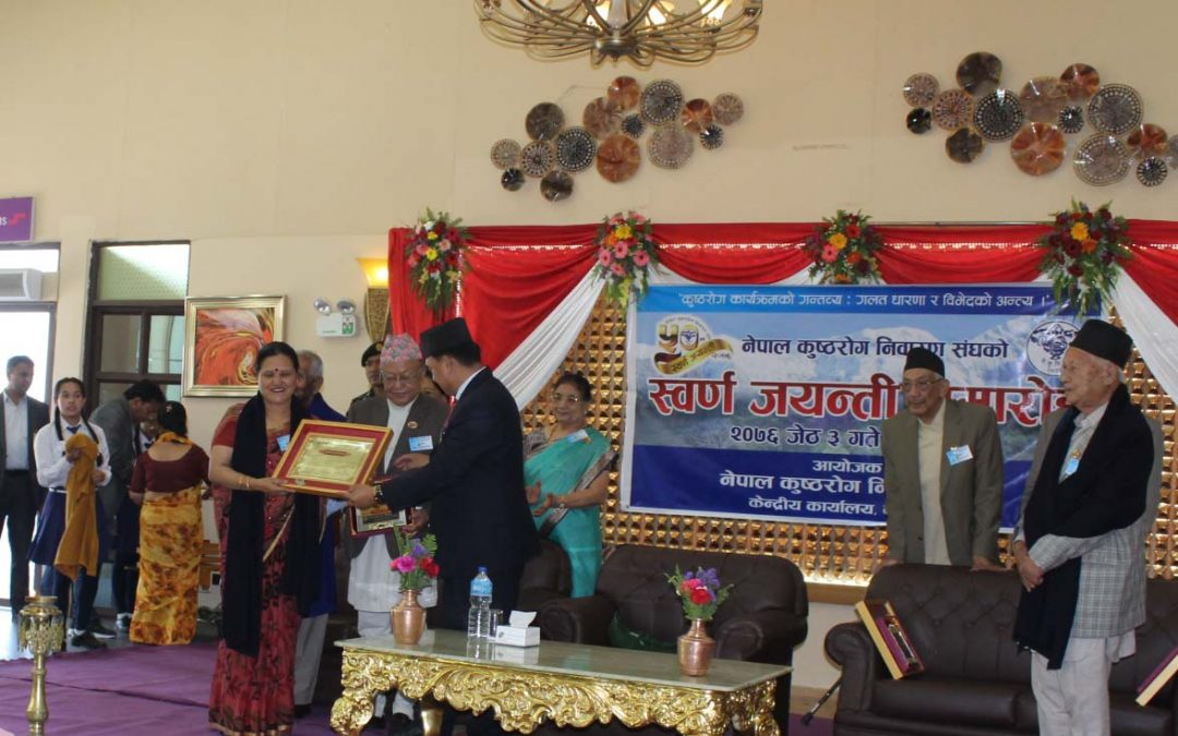 Rt. Honorable Vice President Hands over Certificate of Honor to ADRA